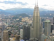 High Angle View Of Petronas Towers In City Against Sky