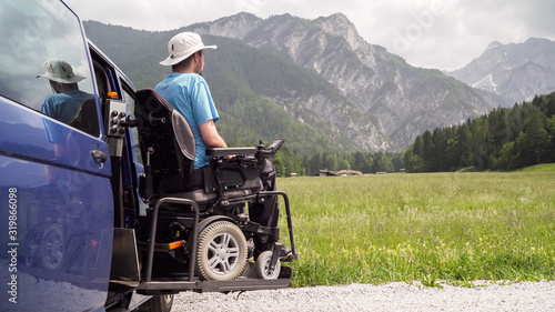 Photo Disabled Man on Wheelchair using Accessible Vehicle with Lift or Ramp in Nature