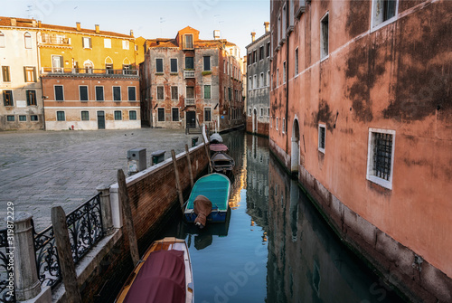 Fototapety, obrazy: Traditional Venice cityscape with narrow canal, moored boats and ancients colorful buildings on square campo Sant'Angelo, Italy