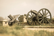 Old Cannons Lined Up, With Tub...