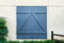 Blue Barn Door White Stone Building