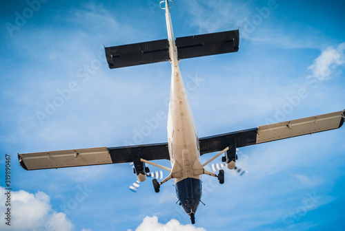 Fototapeta Twin Engine Turbo-Prop Plane - Flying, Air Travel and Vacation Concept