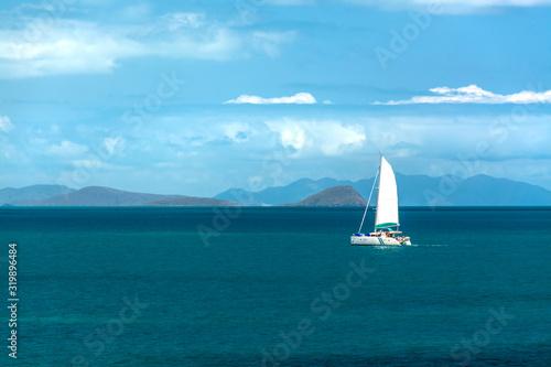 Photo Sailboat in distance, Airlie Beach Australia