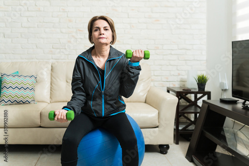 Active Retired Woman Doing Workout Wallpaper Mural