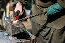Blacksmith Working On Red Iron