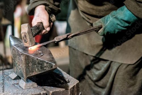 blacksmith working on red iron Canvas Print