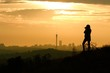 canvas print picture - Silhouette Woman Photographing While Standing On Grass Against Sky During Sunset