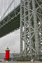Red Lighthouse By Bridge Over Hudson River In City