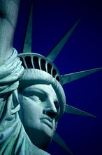 Cropped Image Of Statue Of Liberty Against Clear Blue Sky