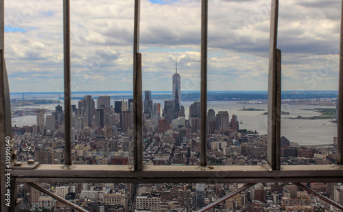 Cityscape With One World Trade Center By River Seen Through Fence Wallpaper Mural