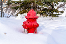 Vibrant Red Fire Hydrant Against Fresh Snow During Winter In Park City Utah