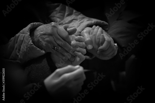 Close-Up Of People Praying By Holding Hands Fototapete