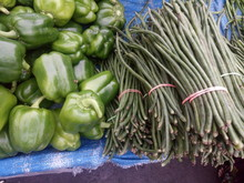 High Angle View Of Green Bell Peppers And Chinese Long Beans At Market For Sale