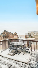 Vertical Snowy Deck Overlooking Homes In The Village Blanketed With Snow In Winter