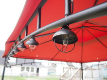 Light Bulbs Hanging On Metal In Red Gazebo