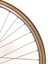 Cropped Image Of Bicycle Tire Against White Wall