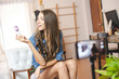 Women broadcast their cosmetics sales live online.