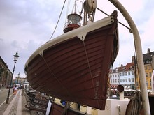 Low Angle View Of Lifeboat Moored At Harbor