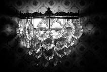 Close-Up Of Illuminated Chandelier In Darkroom