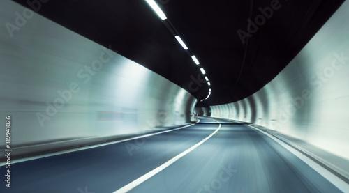 Obraz na plátně Blurred Motion Of Illuminated Empty Tunnel