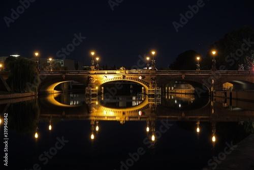 Illuminated Moltke Bridge Over Spree River Against Clear Sky At Night Canvas Print
