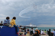People Watching Airshow From E...