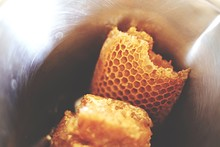 High Angle View Of Honeycombs In Container
