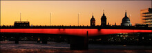 Panoramic View Of Illuminated London Bridge Over River Against Sky At Dusk
