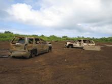 Abandoned Broken Cars At Junkyard Against Cloudy Sky