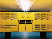 Yellow Mailboxes In Illuminated Room
