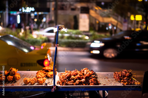 Fried Meat On Market Stall At Night Wallpaper Mural