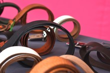 Close-Up Of Belts For Sale