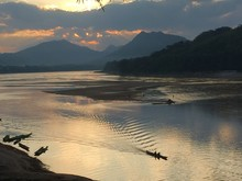 High Angle View Of Mekong River Against Cloudy Sky During Sunset