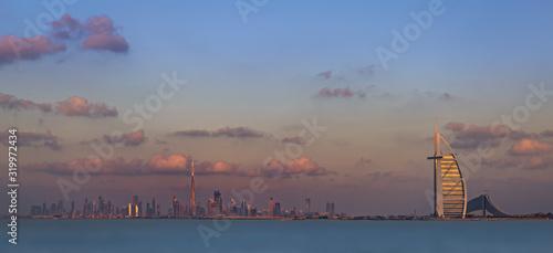 Burj Al Arab Hotel In Front Of River Against Sky At Dusk In City Canvas Print