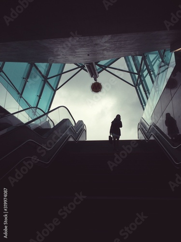 Fotografia, Obraz Low Angle View Of Woman Standing At Metro Centrum Nauki Kopernik