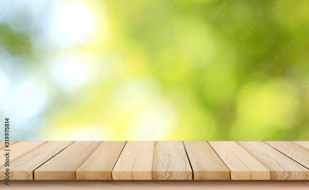 Fototapeta blurred background of green park in summer, Wood table top on shiny bokeh green background. For product display