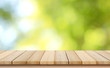blurred background of green park in summer, Wood table top on shiny bokeh green background. For product display