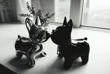 Figurines Of Dogs On Table