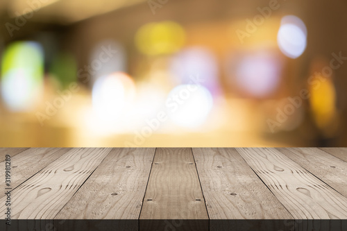 Obraz Empty brown wood table top on blur background at shopping mall, copy space for montage you product - fototapety do salonu