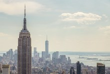 Empire State Building Against Towers At Manhattan