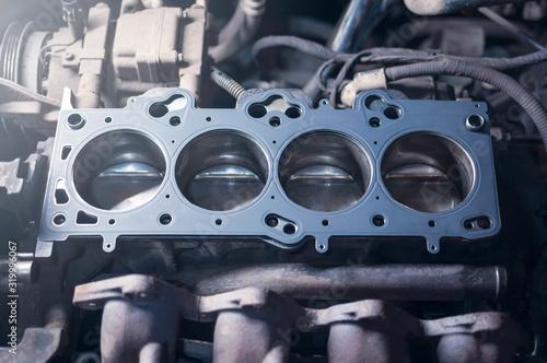 Fotografía Car engine repair. cylinder head gasket replacement in workshop
