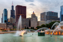 Chicago Skyline At Sunset And Buckingham Fountain, Chicago, Illinois, USA.