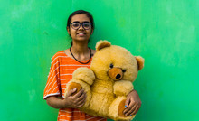 Young Teenager Girl With Teddy...
