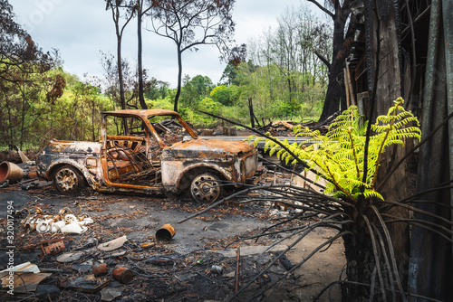 Australian bushfire aftermath: Burnt car and rubble at Bilpin in Blue Mountains, Australia Wallpaper Mural