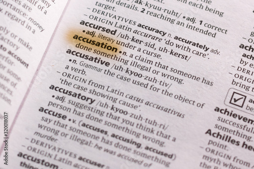 Photo The word or phrase Accusation in a dictionary.