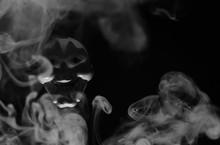 White Scary Mask On A Black Ba...