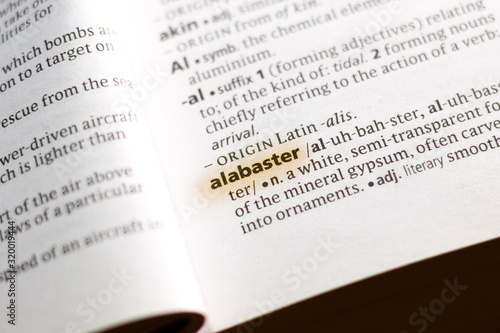 Photo The word or phrase Alabaster in a dictionary.