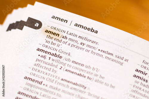 Photo The word or phrase Amen in a dictionary.