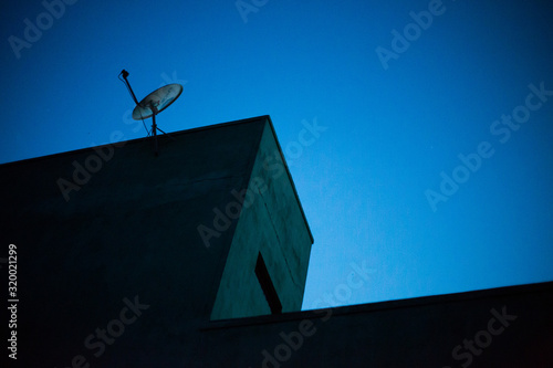 Fototapeta Low angle view of antenna against clear blue sky