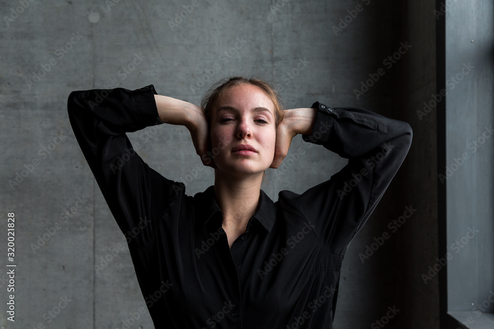 Fototapeta Young Caucasian Woman Covering Ears with Hands